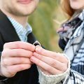 couple-looking-at-engagement-ring-after-she-accepts